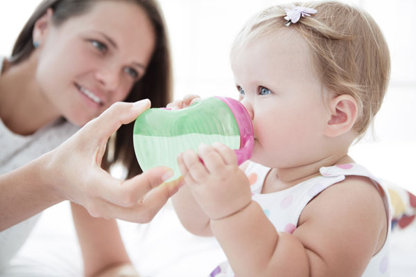 Little girl drinks infant formula
